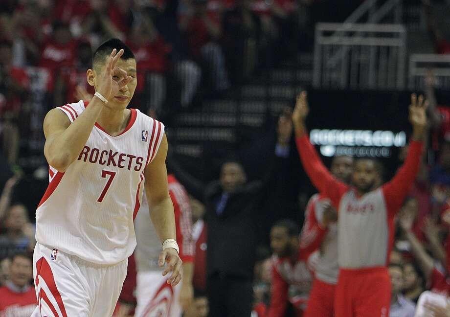 Rockets guard Jeremy Lin motions after scoring a 3-point shot. Photo: James Nielsen, Houston Chronicle