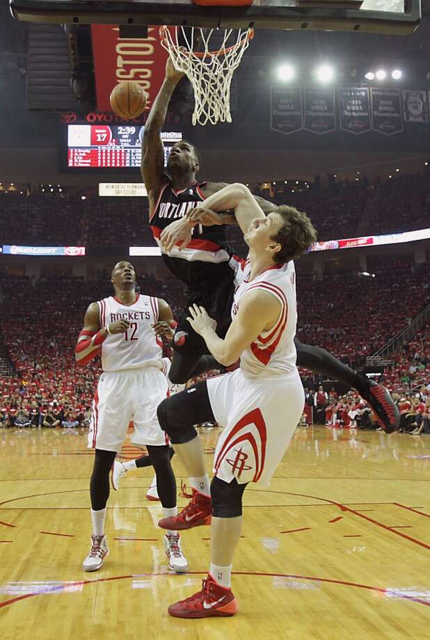 Trail Blazers forward Thomas Robinson left, misses a slam dunk over Rockets center Omer Asik. Photo: James Nielsen, Houston Chronicle