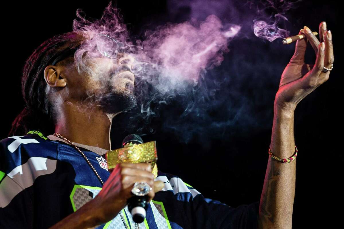 Snoop Dogg exhales lungfuls of blunt smoke on stage during ?'Snoop's Wellness Retreat?