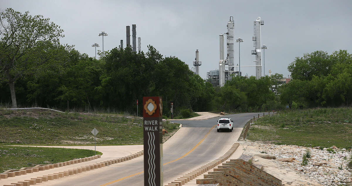 Calumet's refinery rises above Mission Parkway near Espada Dam. Two recent refinery spills of jet fuel have affected the river.