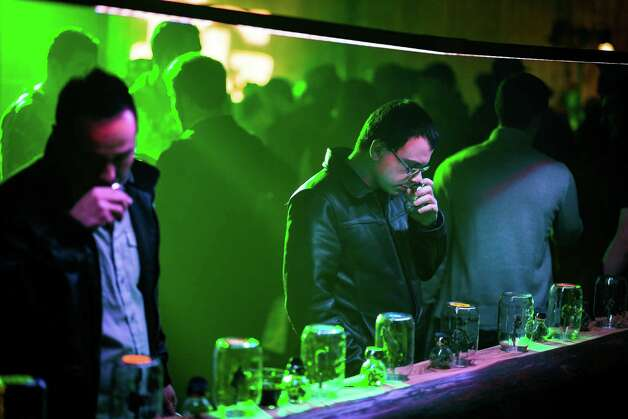 In celebration of Ò4/20 Eve,Ó guests sniff and observe cannabis strains from across Washington at the third annual DOPE Cup Saturday, April 19, 2014, at Magical Butter Studios in Seattle, Wash. The winning strains will be featured on the May cover of DOPE Magazine. Photo: JORDAN STEAD, SEATTLEPI.COM / SEATTLEPI.COM
