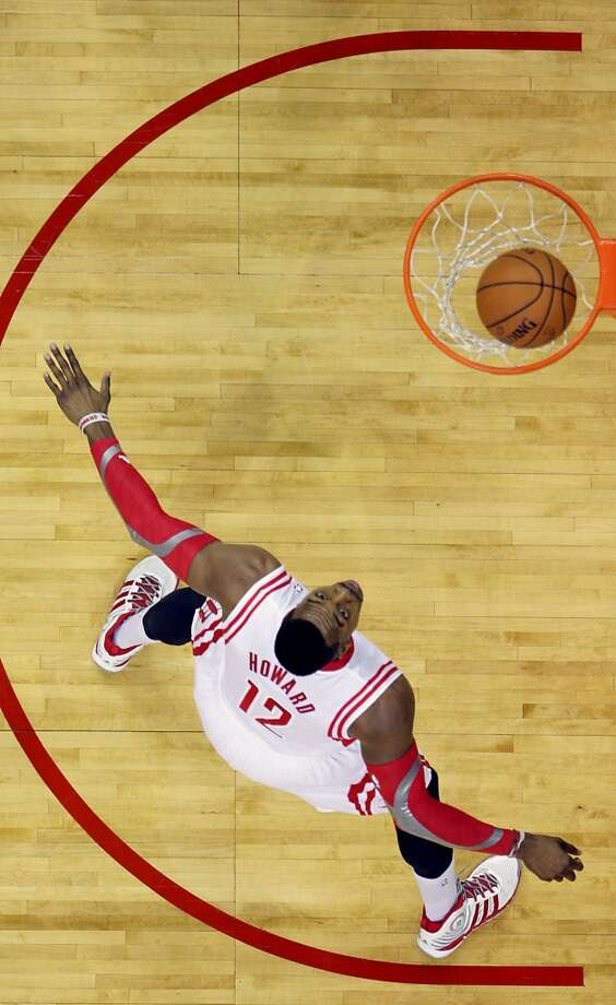 Rockets center Dwight Howard  watches a shot fall in the basket. Photo: James Nielsen, Houston Chronicle