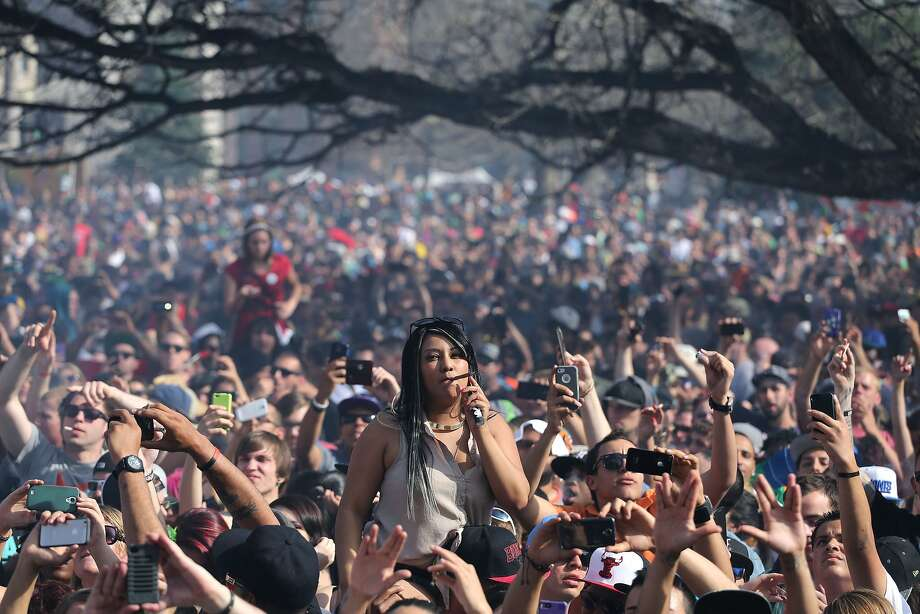 Partygoers celebrate music and marijuana at the annual pot festival in Denver - the first 4/20 celebration since Colorado voters legalized cannabis. Photo: Brennan Linsley, Associated Press