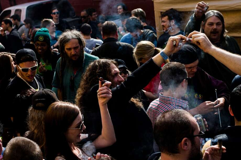 Marijuana advocates and event attendees enjoy a 4:20 p.m. group smoke at Seattle Hempfest 420Fest Sunday, April 20, 2014, at Factory Lux in Seattle, Wash. (Jordan Stead, seattlepi.com) Photo: JORDAN STEAD, SEATTLEPI.COM