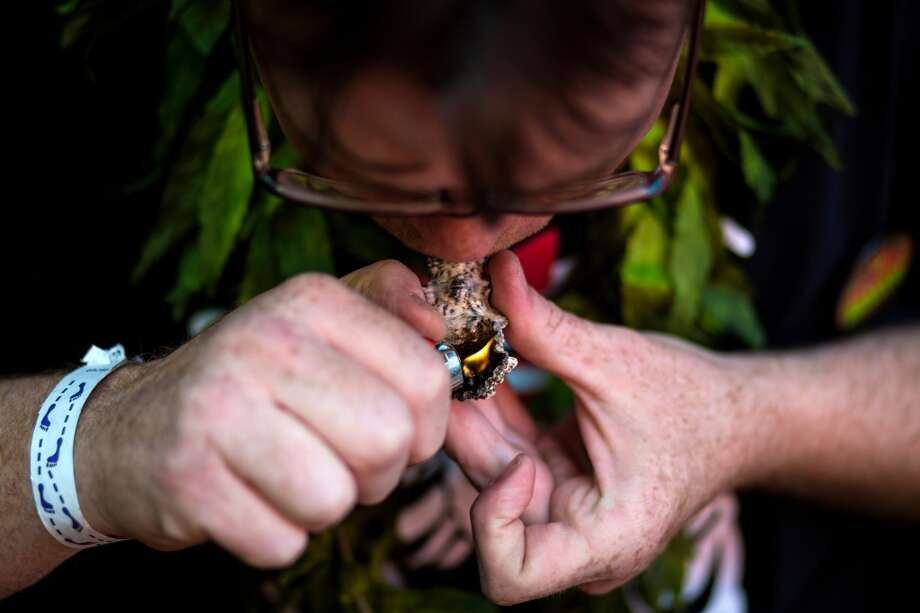 Bellingham resident Jeremy Tillman takes part in a 4:20 p.m. group smoke at Seattle Hempfest 420Fest Sunday, April 20, 2014, at Factory Lux in Seattle, Wash. (Jordan Stead, seattlepi.com) Photo: JORDAN STEAD, SEATTLEPI.COM