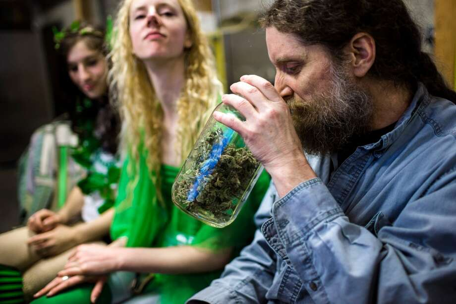 In celebration of the first year legalization of recreational marijuana in Washington, visitors attended Cannabis Carnivalus to take part in joint rolling classes, a smoking bus and medicated massages Sunday, April 20, 2014, at Melrose Market Studios in Seattle, Wash. (Jordan Stead, seattlepi.com) Photo: JORDAN STEAD, SEATTLEPI.COM