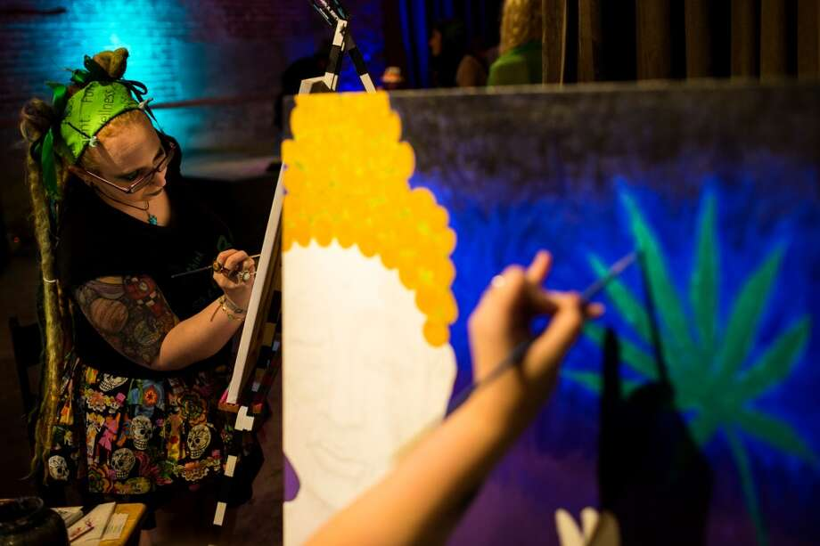 In celebration of the first year legalization of recreational marijuana in Washington, Sami Saurus paints at Cannabis Carnivalus Sunday, April 20, 2014, at Melrose Market Studios in Seattle, Wash. (Jordan Stead, seattlepi.com) Photo: JORDAN STEAD, SEATTLEPI.COM