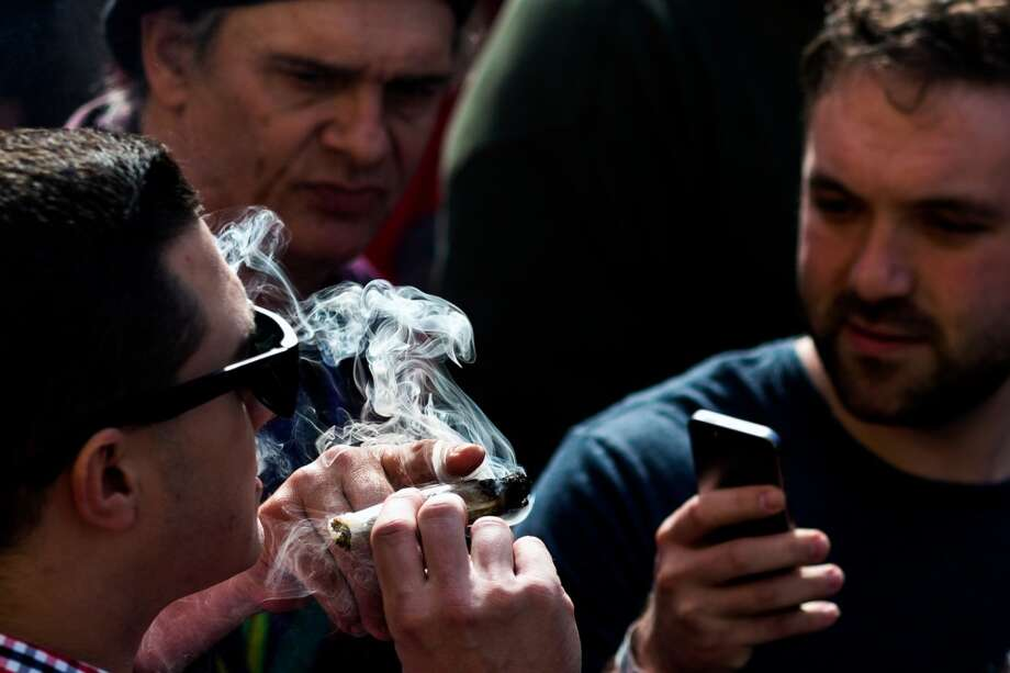 Marijuana advocates and event attendees enjoy joint rolling sessions and a 4:20 p.m. group smoke at Seattle Hempfest 420Fest Sunday, April 20, 2014, at Factory Lux in Seattle, Wash. (Jordan Stead, seattlepi.com) Photo: JORDAN STEAD, SEATTLEPI.COM
