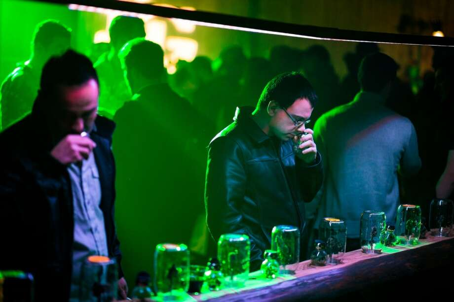 In celebration of ''4/20 Eve,'' guests sniff and observe cannabis strains from across Washington at the third annual DOPE Cup Saturday, April 19, 2014, at Magical Butter Studios in Seattle, Wash. The winning strains will be featured on the May cover of DOPE Magazine. (Jordan Stead, seattlepi.com) Photo: JORDAN STEAD, SEATTLEPI.COM