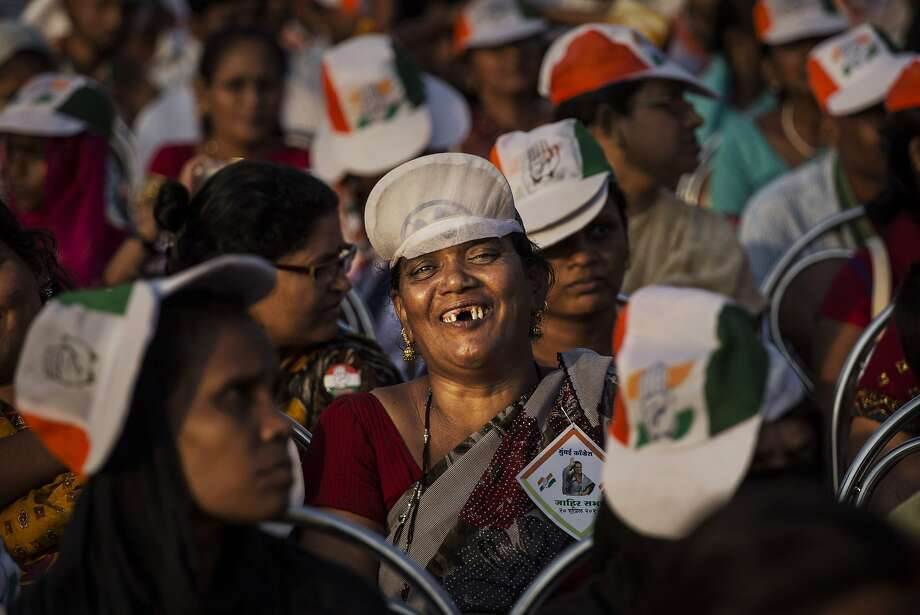 MUMBAI, INDIA - APRIL 20:  A supporter of India's ruling Congress Party listens to speeches during a rally on April 20, 2014 in Mumbai, India. India is in the midst of a nine phase election that began on April 7 and ends May 12.  (Photo by Kevin Frayer/Getty Images) Photo: Kevin Frayer, Getty Images