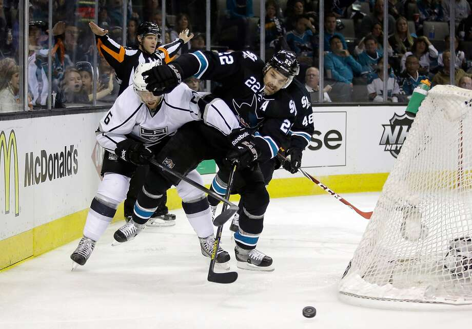 The Kings' Jake Muzzin (left) gets tangled with the Sharks' Dan Boyle behind the goal. Muzzin had a goal and Boyle two assists in San Jose's Game 2 win. Photo: Ezra Shaw, Getty Images