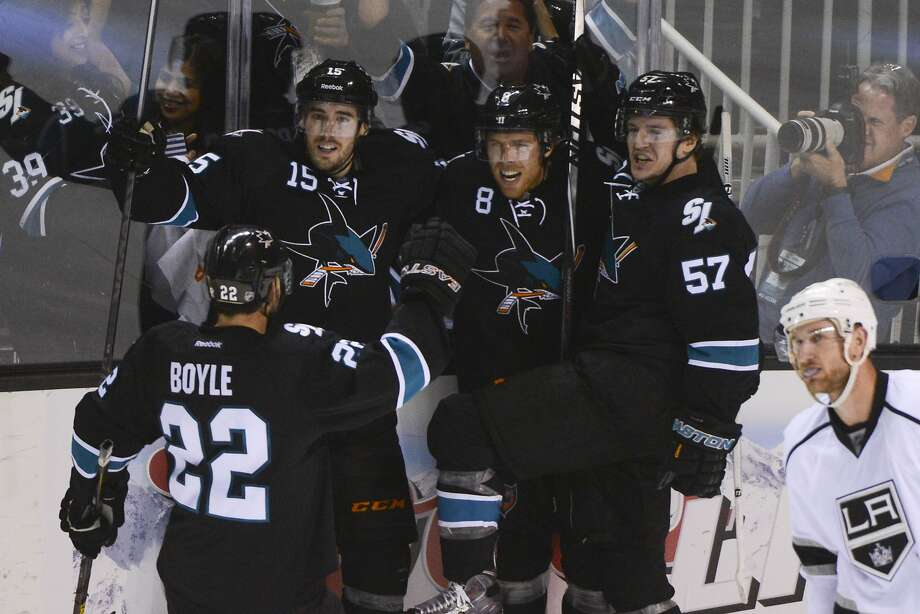 Joe Pavelski (8) is the goal scorer at the center of this celebra- tion Sunday, but all four of the Sharks' lines have gotten into the scoring action in the first two games of the quarter- final series. Photo: Kyle Terada, Reuters