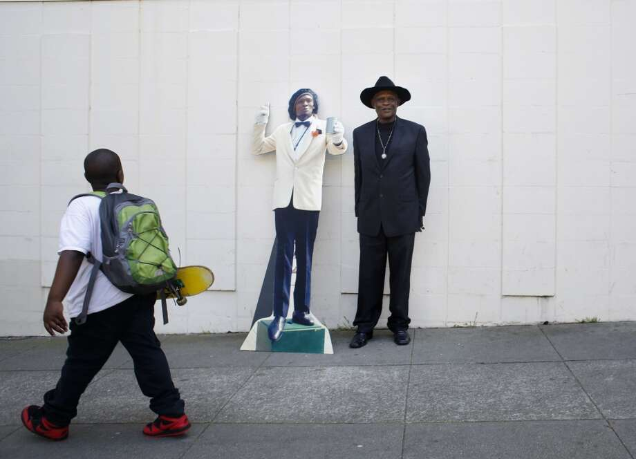 Retired from street performing, Elisha Whittington shows off a life-sized cardboard cutout of himself in from of his home in the Mission on Tuesday April 15, 2014 in San Francisco, Calif. Photo: Mike Kepka, The Chronicle