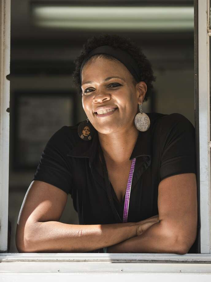 Nyjuma Howard poses in the window of her food truck Wednesday afternoon. Howard owns and operates the Jamaican Cajun food truck, which can be found at various locations throughout the week. Photo taken Wednesday, 4/9/14 Jake Daniels/@JakeD_in_SETX