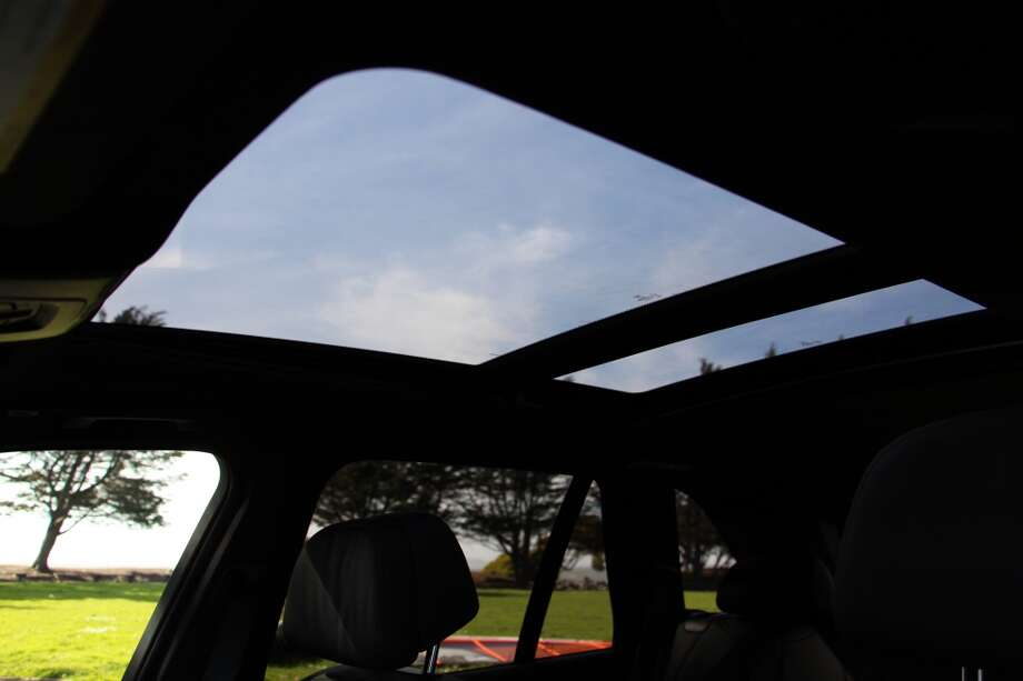 The X5's standard panoramic moonroof has two giant pieces of glass. The front section slides back.