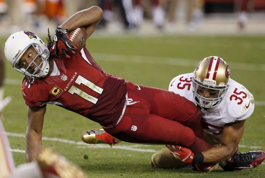 32. Arizona CardinalsAverage pay per player: $1,123,249Highest paid player: Wide receiver Larry Fitzgerald2013 earnings:  $10.25 million Photo: Ross D. Franklin, AP