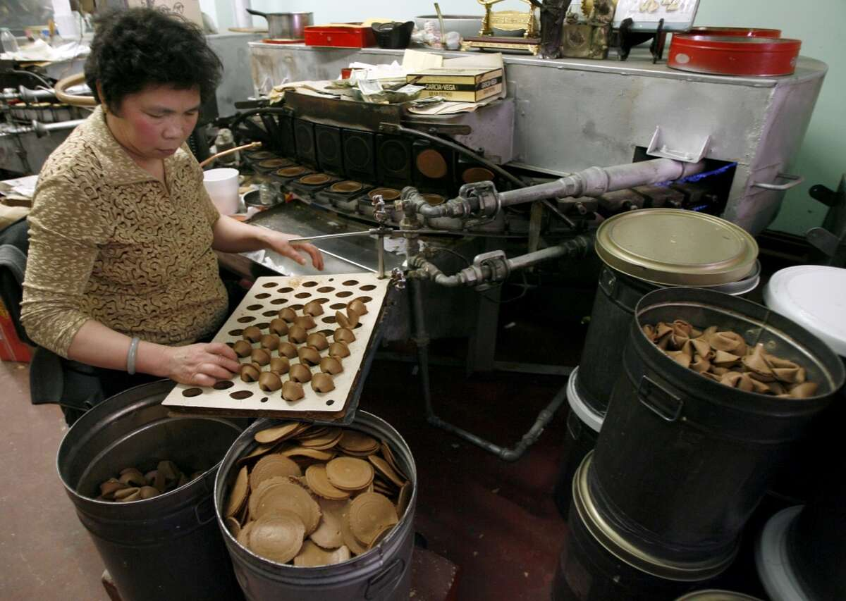 Making cookies at the Golden Gate Fortune Cookie Factory in San Francisco.