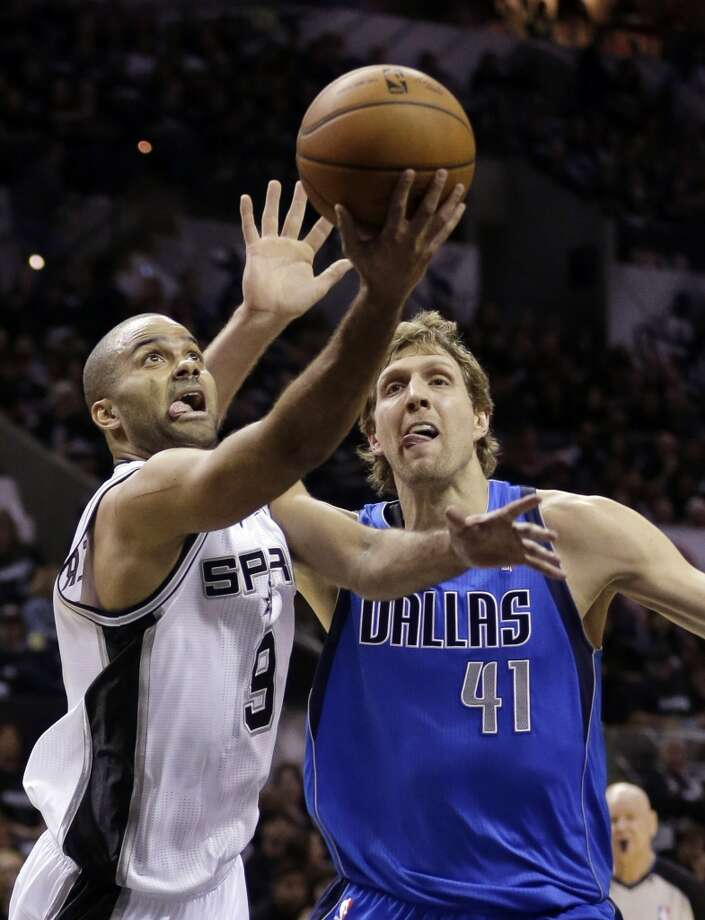 San Antonio Spurs' Tony Parker (9), of France, shoots around Dallas Mavericks' Dirk Nowitzki (41), of Germany, during the first quarter of Game 1 of the opening-round NBA basketball playoff series on Sunday, April 20, 2014, in San Antonio. (AP Photo/Eric Gay) Photo: Eric Gay, Associated Press