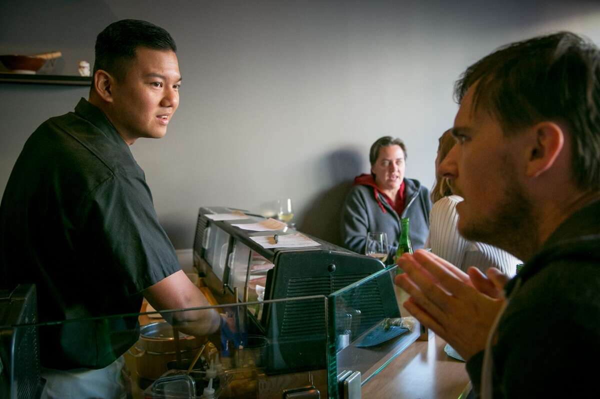 Daniel Realin talks with a customer at the sushi bar at Ichi Sushi in San Francisco.