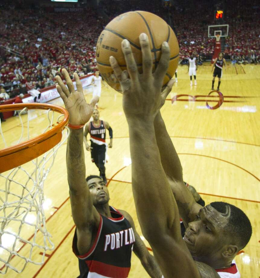 Houston Rockets forward Terrence Jones, right, dunks against the Portland Trail Blazers during the first quarter of an NBA playoff basketball game at Toyota Center Sunday, April 20, 2014, in Houston. ( Brett Coomer / Houston Chronicle ) Photo: Brett Coomer, Houston Chronicle