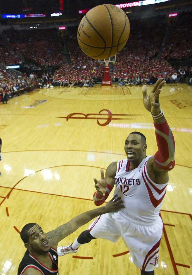 Houston Rockets center Dwight Howard (12) goes up for a shot against the Portland Trail Blazers during the first half  of an NBA playoff basketball game at Toyota Center Sunday, April 20, 2014, in Houston. ( Brett Coomer / Houston Chronicle ) Photo: Brett Coomer, Houston Chronicle