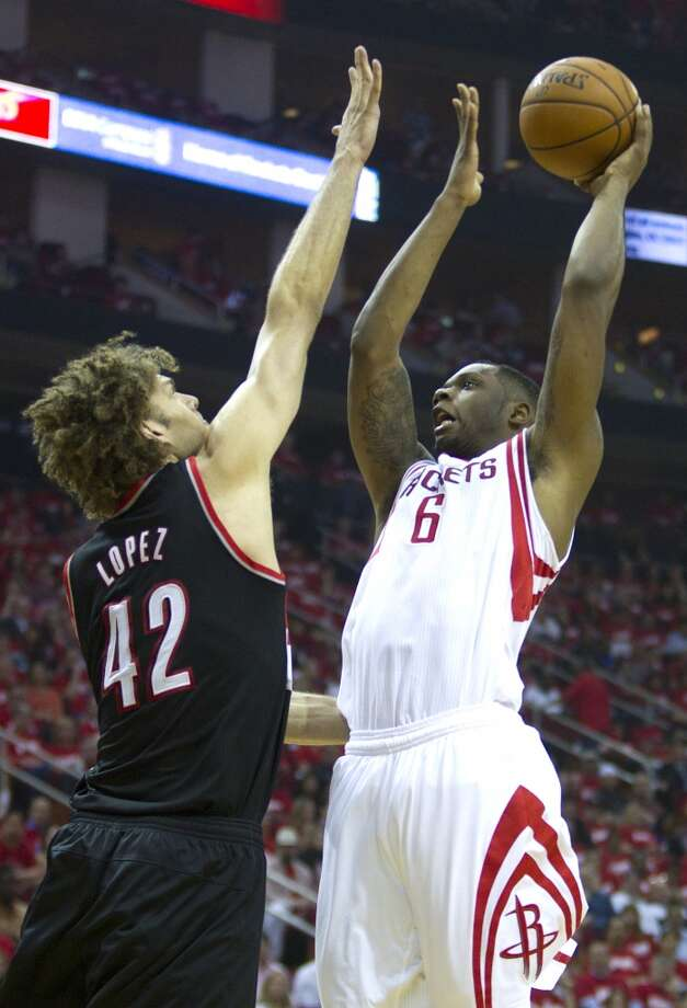 Houston Rockets forward Terrence Jones (6) shoots over Portland Trail Blazers center Robin Lopez (42) during the second quarter of an NBA playoff basketball game at Toyota Center Sunday, April 20, 2014, in Houston. ( Brett Coomer / Houston Chronicle ) Photo: Brett Coomer, Houston Chronicle