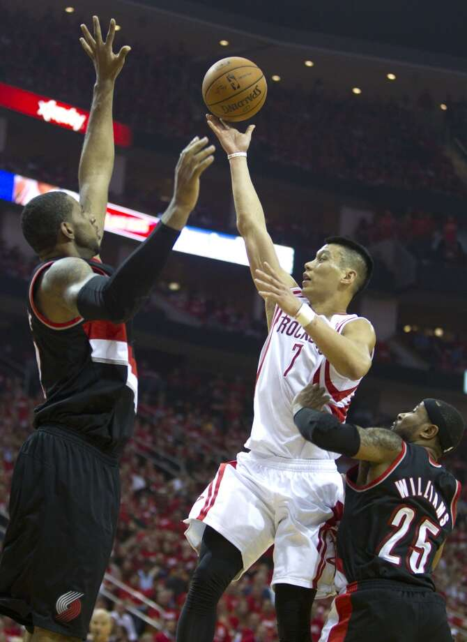 Houston Rockets guard Jeremy Lin (7) drives past Portland Trail Blazers guard Mo Williams (25) for a layup during the second quarter of an NBA playoff basketball game at Toyota Center Sunday, April 20, 2014, in Houston. ( Brett Coomer / Houston Chronicle ) Photo: Brett Coomer, Houston Chronicle
