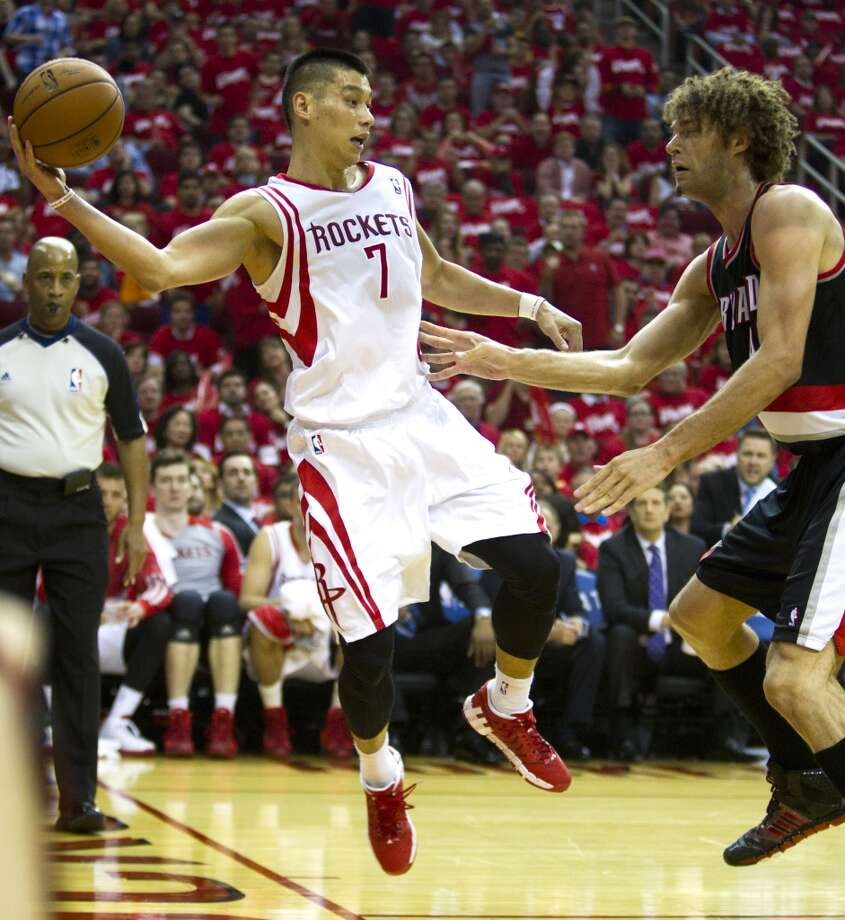 Houston Rockets guard Jeremy Lin (7) throws the ball back inbounds with Portland Trail Blazers center Robin Lopez (42) defending during the second quarter of an NBA playoff basketball game at Toyota Center Sunday, April 20, 2014, in Houston. ( Brett Coomer / Houston Chronicle ) Photo: Brett Coomer, Houston Chronicle
