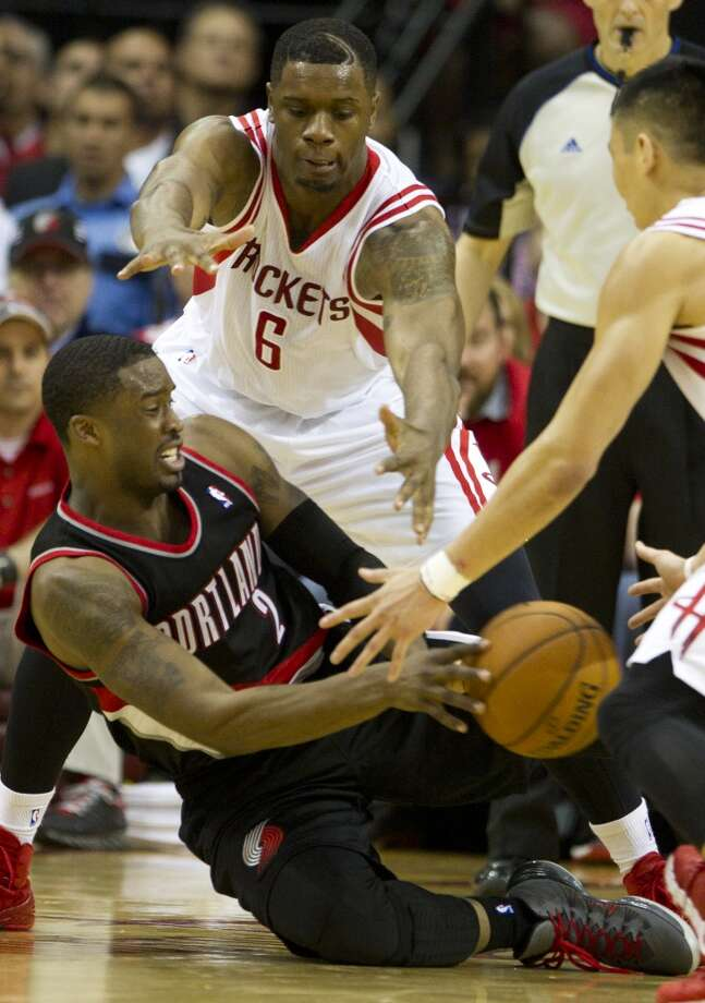 Portland Trail Blazers guard Wesley Matthews (2) and Houston Rockets forward Terrence Jones (6) go after a loose ball during the fourth quarter of an NBA playoff basketball game at Toyota Center Sunday, April 20, 2014, in Houston. ( Brett Coomer / Houston Chronicle ) Photo: Brett Coomer, Houston Chronicle