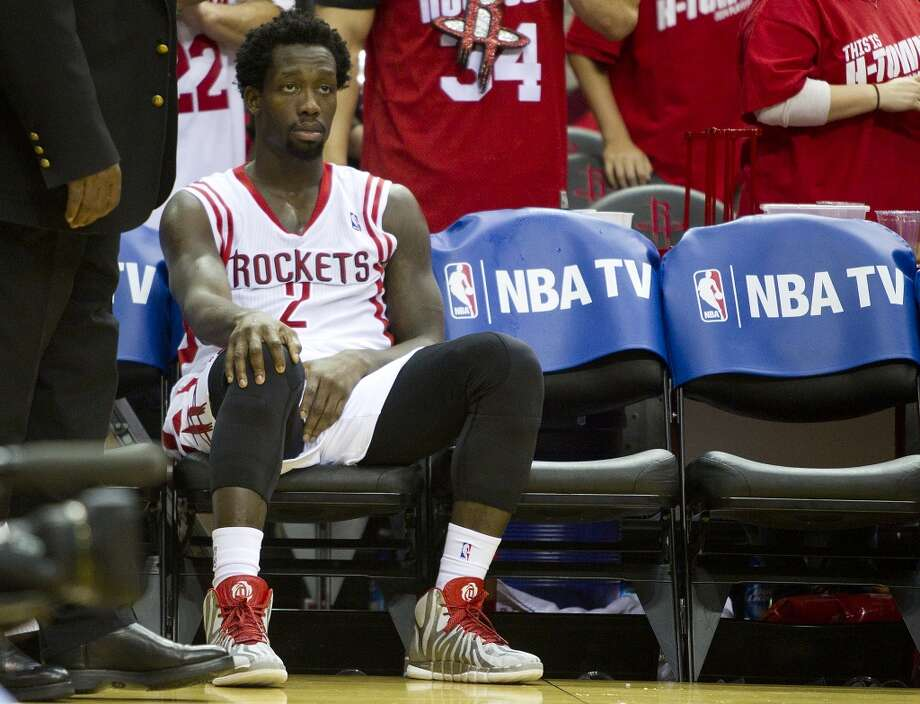 Houston Rockets guard Patrick Beverley sits alone on the bench during a time out in overtime in an NBA playoff basketball game against the Portland Trail Blazers at Toyota Center Monday, April 21, 2014, in Houston. ( Brett Coomer / Houston Chronicle ) Photo: Brett Coomer, Houston Chronicle