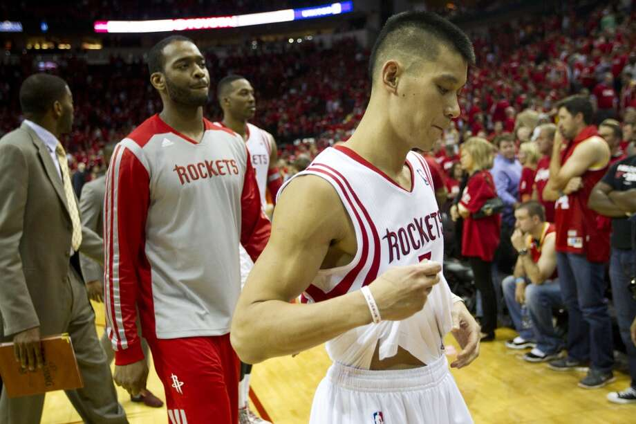 Houston Rockets guard Jeremy Lin (7) walks off the court after the Rockets loss to the Portland Trail Blazers in overtime in an NBA playoff basketball game at Toyota Center Monday, April 21, 2014, in Houston. ( Brett Coomer / Houston Chronicle ) Photo: Brett Coomer, Houston Chronicle