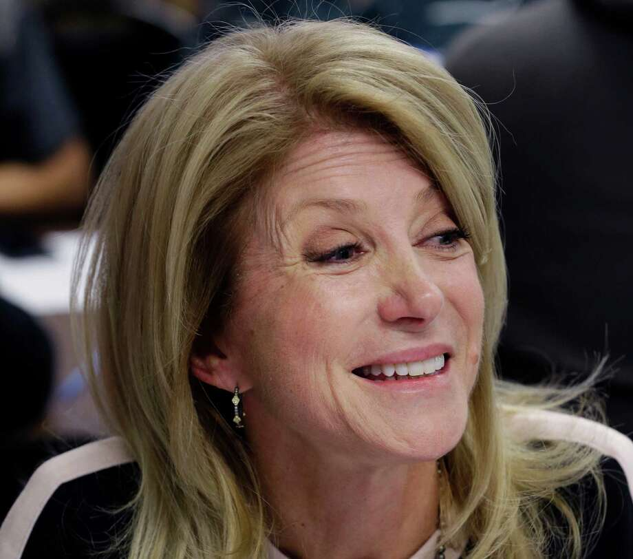 Democratic gubernatorial candidate  Wendy Davis' votes as a state senator fit snugly with the interests of her law firm. Photo: LM Otero, Associated Press / AP