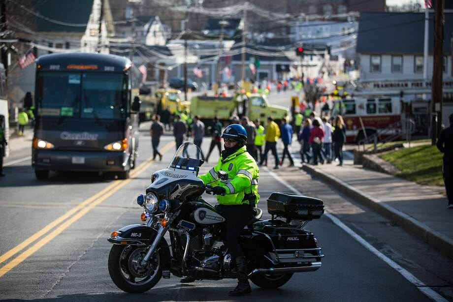 A Massachusetts State Police officer stands guard prior to the start of the Boston Marathon on April 21, 2014 in Hopkington, Massachusetts. Today marks the 118th Boston Marathon; security presence has been increased this year, due to two bombs that were detonated at the finish line last year, killing three people and injuring more than 260 others. Photo: Andrew Burton, Getty Images