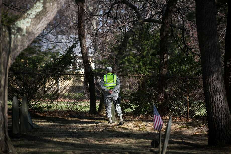 A Military Police officer stands guard in a cemetery prior to the start of the Boston Marathon on April 21, 2014 in Hopkington, Massachusetts. Today marks the 118th Boston Marathon; security presence has been increased this year, due to two bombs that were detonated at the finish line last year, killing three people and injuring more than 260 others.  Photo: Andrew Burton, Getty Images