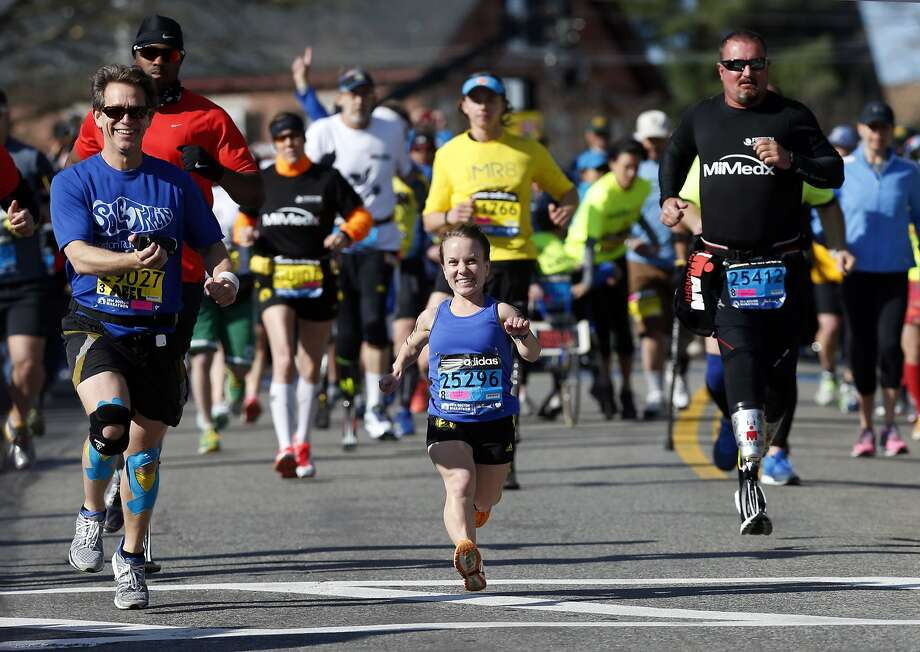 Mobility-impaired runners David Abel, left, Juli Windsor, and Scott Rigsby compete in the 118th Boston Marathon Monday, April 21, 2014 in Hopkinton, Mass.  Photo: Michael Dwyer, Associated Press