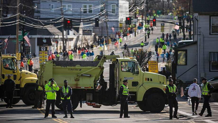 Law enforcement officials, media, runners, administrators and volunteers mill about prior to the start of the Boston Marathon  on April 21, 2014 in Hopkington, Massachusetts. Today marks the 118th Boston Marathon; security presence has been increased this year, due to two bombs that were detonated at the finish line last year, killing three people and injuring more than 260 others.  Photo: Andrew Burton, Getty Images