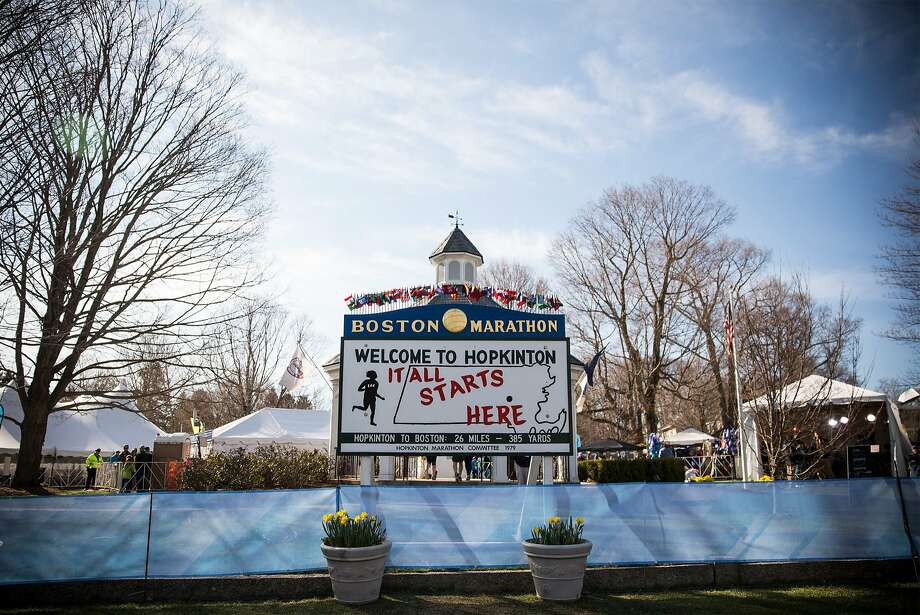 The starting line of the Boston Marathon is marked with a sign on April 21, 2014 in Hopkington, Massachusetts. Today marks the 118th Boston Marathon; security presence has been increased this year, due to two bombs that were detonated at the finish line last year, killing three people and injuring more than 260 others.  Photo: Andrew Burton, Getty Images