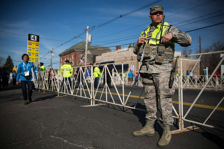 A Military Police officer stands guard prior to the start of the Boston Marathon on April 21, 2014 in Hopkington, Massachusetts. Today marks the 118th Boston Marathon; security presence has been increased this year, due to two bombs that were detonated at the finish line last year, killing three people and injuring more than 260 others.  Photo: Andrew Burton, Getty Images