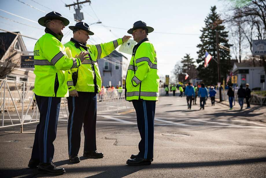 Massachusetts State Police stand guard prior to the start of the Boston Marathon on April 21, 2014 in Hopkington, Massachusetts. Today marks the 118th Boston Marathon; security presence has been increased this year, due to two bombs that were detonated at the finish line last year, killing three people and injuring more than 260 others. Photo: Andrew Burton, Getty Images