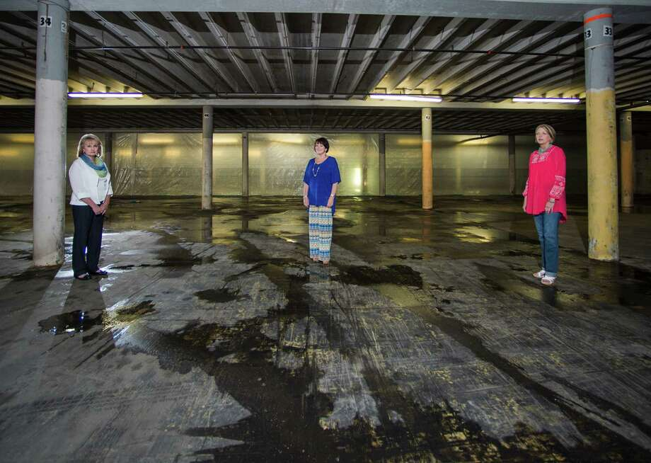 Deborah Johannson, Sheri Arnold, and Debbie Cowart, left to right, pose for a photo in a warehouse their company is currently renovating for sale. Coldwell Banker Commercial real estate is renovating the Finger Furniture warehouse off 7th Street. Photo taken Thursday, 4/17/14 Jake Daniels/@JakeD_in_SETX Photo: Jake Daniels / ©2014 The Beaumont Enterprise/Jake Daniels