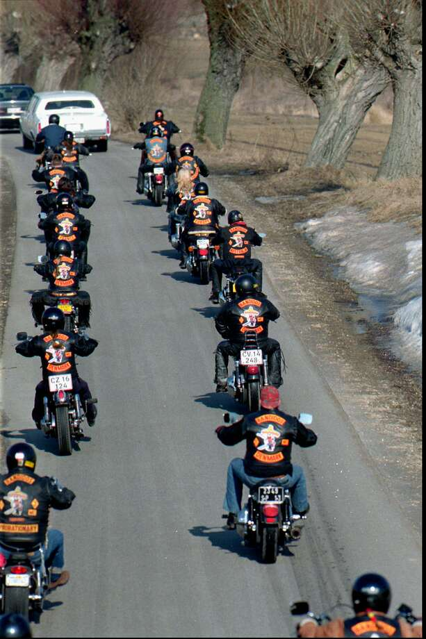 Bandidos Outlaw Motorcycle GangTier 2 ThreatDPS:Formed in the 1960s, the Bandidos Outlaw Motorcycle Gang  (Bandidos OMG) conducts its illegal activities as covertly as possible  and avoids high-profile activities such as drive-by shootings that  many street gangs tend to commit. However, members are not covert  about making their presence known by wearing the gang colors,  insignia, and riding in large groups. They seek to turn public  sentiment in their favor by organizing frequent charity runs.  Bandidos are likely to focus on recruiting new members with no  criminal history. Above: European, Australian and U.S. members of the Houston, Texas-led Bandidos gang on way Wednesday, March 20,1996, to the funeral of their Danish comrade Uffe Larsen at the church in the village Stenloese 35 kilometers northwest of Copenhagen. Photo: JOERGEN JESSEN, .