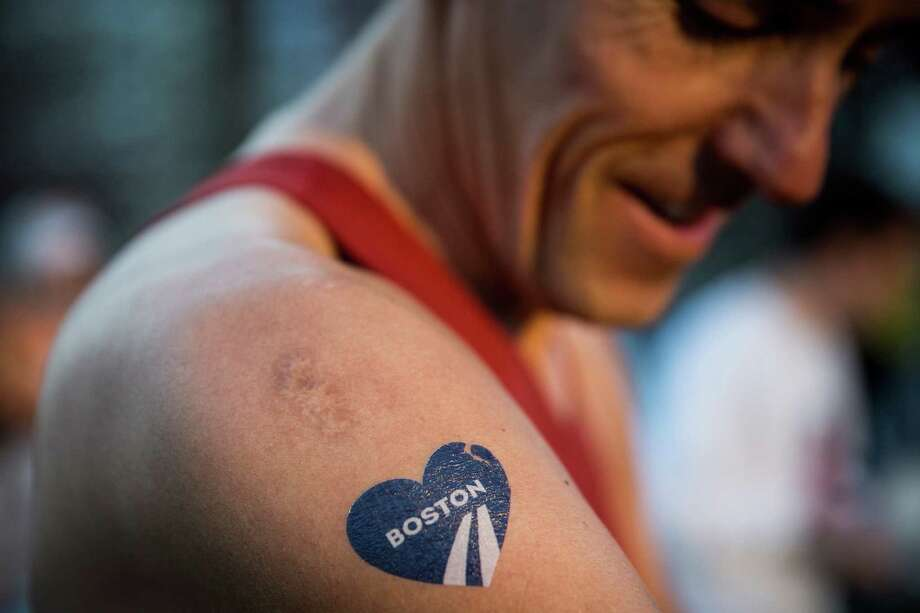 A runner with a temporary Boston Marathon tattoo gets ready to run the 118th Boston Marathon in the Boston Commons on April 21, 2014 in Boston, Massachusetts. Today marks the 118th Boston Marathon; security presence has been increased this year, due to two bombs that were detonated at the finish line last year, killing three people and injuring more than 260 others.  Photo: Andrew Burton / Getty Images / 2014 Getty Images
