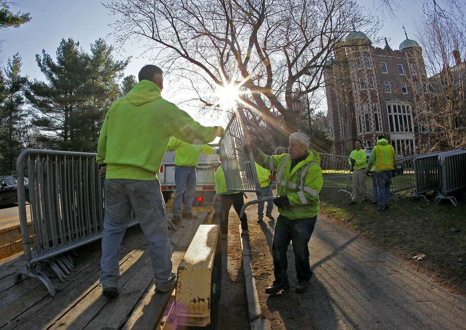Workers move security gates into position in front of Wellesley College in the early morning before the start of the 118th Boston Marathon Monday, April 21, 2014 in Wellesley, Mass. Photo: Mary Schwalm, Associated Press