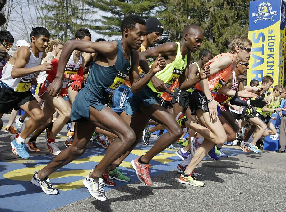 Elite men runners leave the start line in the 118th running of the Boston Marathon Monday, April 21, 2014 in Hopkinton, Mass.  Photo: Stephan Savoia, Associated Press
