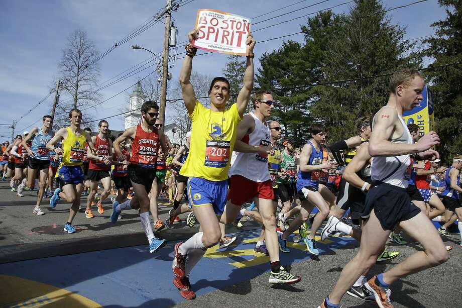 Runners in the first wave of 9,000 cross the start line of the 118th Boston Marathon Monday, April 21, 2014 in Hopkinton, Mass.  (AP Photo/Stephan Savoia) Photo: Stephan Savoia, Associated Press