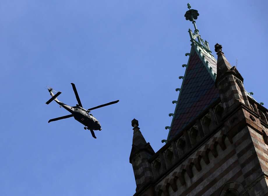 A military helicopter flies past Old South Church near the finish line during the 118th Boston Marathon Monday, April 21, 2014 in Boston. (AP Photo/Elise Amendola) Photo: Elise Amendola, Associated Press