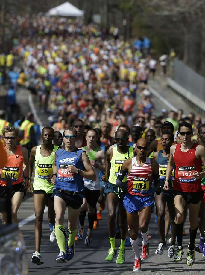The elite men's runners compete near the start of the 118th Boston Marathon Monday, April 21, 2014 in Hopkinton, Mass. (AP Photo/Steven Senne) Photo: Steven Senne, Associated Press