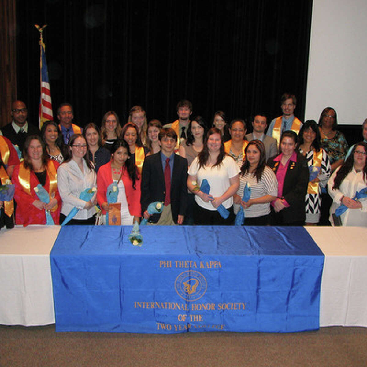 Twenty-eight students participated in the spring Phi Theta Kappa induction ceremony at College of the Mainland.