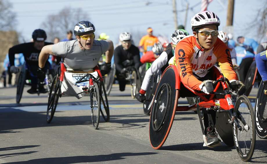 Participants in the wheelchair division of the 118th Boston Marathon start their race Monday, April 21, 2014 in Hopkinton, Mass. Photo: Stephan Savoia, Associated Press