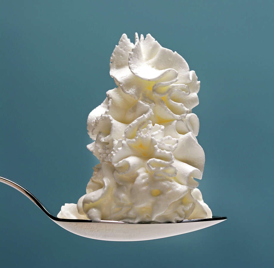 Who doesn't like whipped cream? At least 36 percent of ice cream lovers think it's the best way to top their favorite treat. Photo: Ricardo DeAratanha, Los Angeles Times / Los Angeles Times